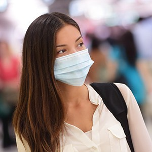 Person wearing protective mask in airport
